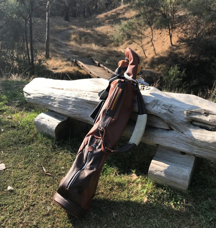 macdonald golf bag learning on a log