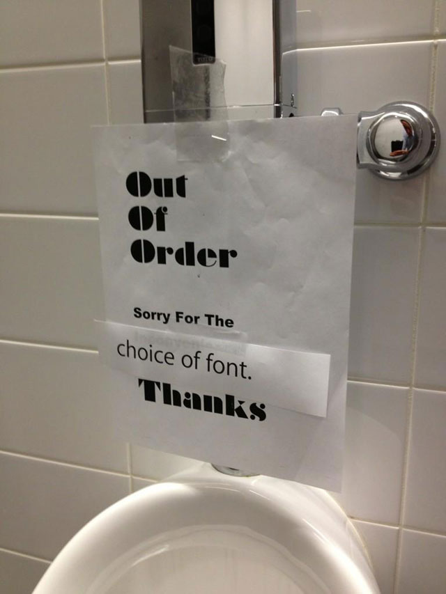 Apple bathroom sign