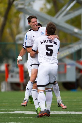 FC Edmonton captain Albert Watson and forward Daryl Fordyce embrace after scoring a goal.