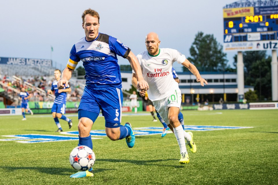 FC Edmonton captain Albert Watson chases down  the ball against the New York Cosmos at James Shuart Stadium in Uniondale, N.Y., on Aug. 6, 2014.