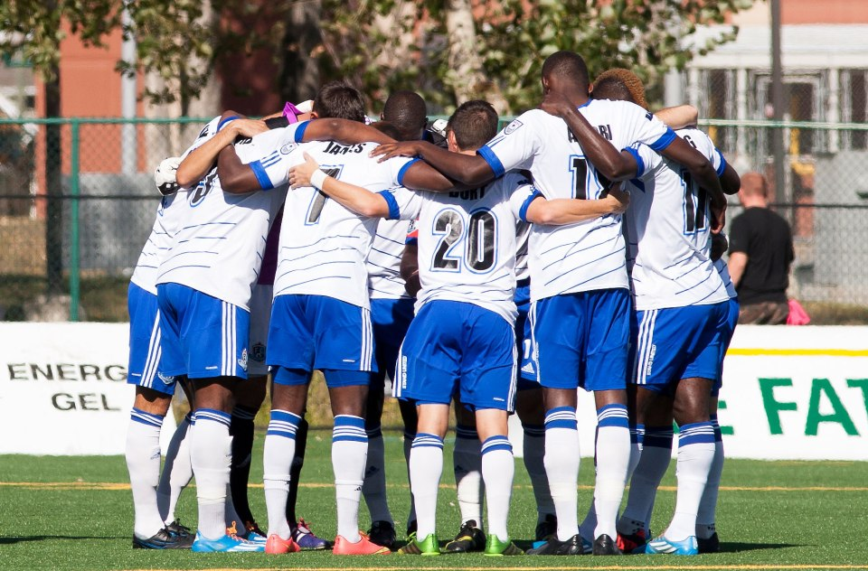 FC Edmonton players huddle in preparation for a match in 2014.