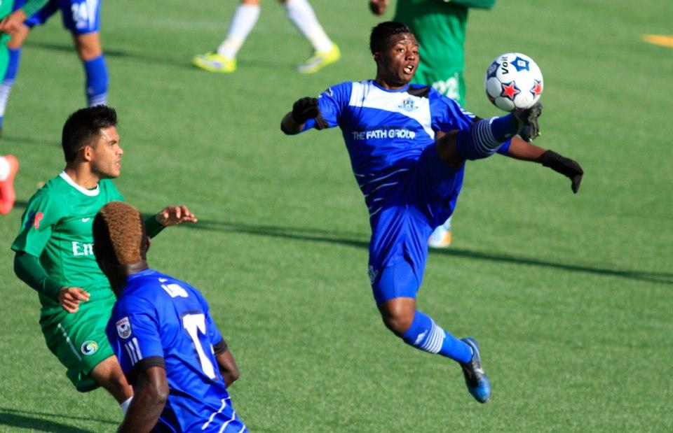 FC Edmonton forward Hanson Boakai reaches for a ball against the New York Cosmos in 2014.