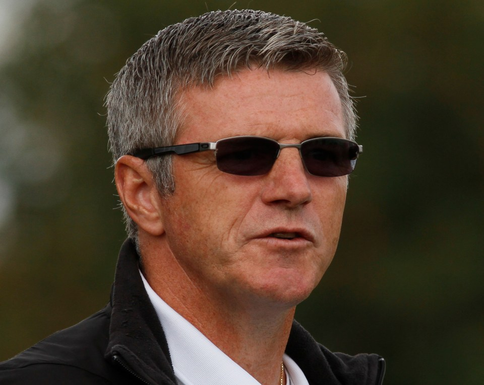 FC Edmonton head coach Colin Miller looks on.