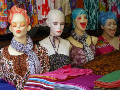 Colourful mannequin busts with big smiles model bright fashions
