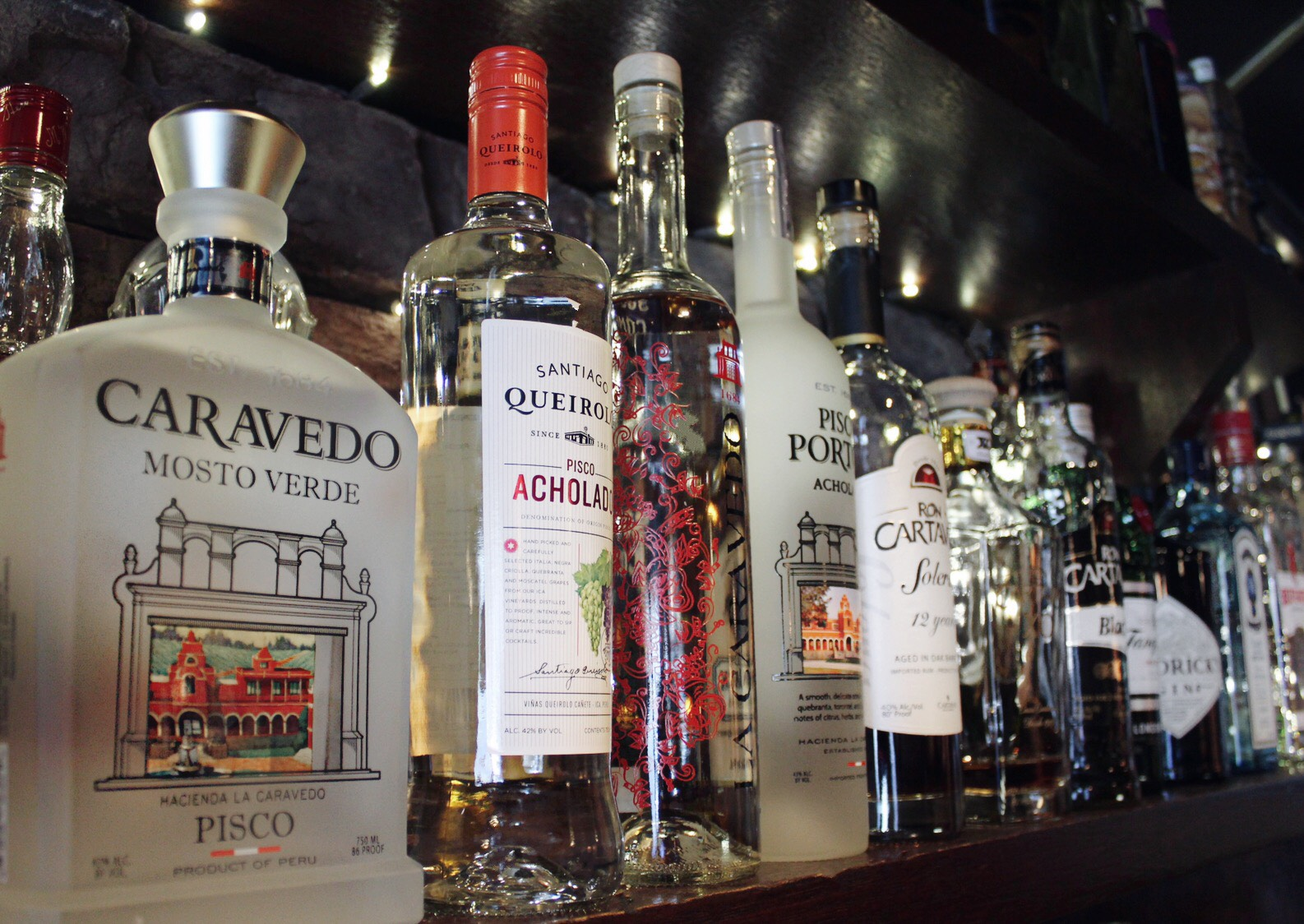 pisco bottle bar shelf