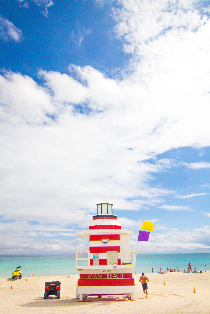 White and red lifeguard tower in South Beach, Miami