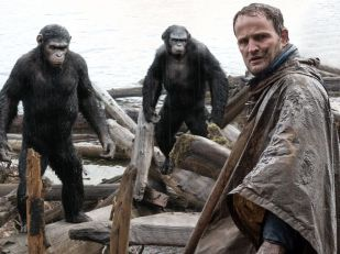 """Malcolm (Jason Clarke) tries to make peace with Caesar, left (Andy Serkis) and Koba (Toby Kebbell). Caesar is a father (two kids at home) and husband, while Clarke has a son who has survived the virus. """"The film centers around the notion of family,"""" says Serkis. """"It's the survival of family and what lengths you will go to in order to protect them."""""""