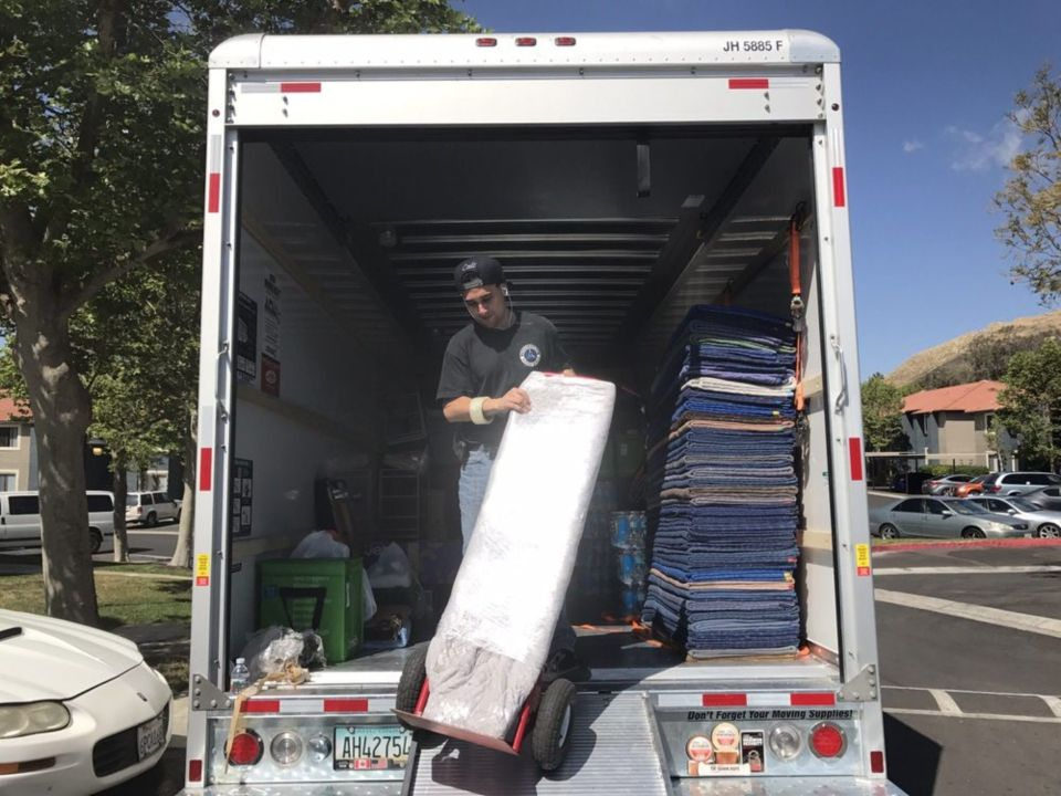 man loading moving truck