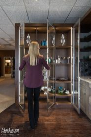 chromed glass and walnut display cabinet with interior automatic lighting