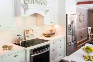 Zodiaq Quartz Coarse Carrara Color Waves Tile Backsplash Mouser Cabinetry stove hood oven range Newtown Square PA