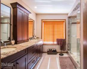 This Master Bathroom has warm notes of Cherry Wood and Granite