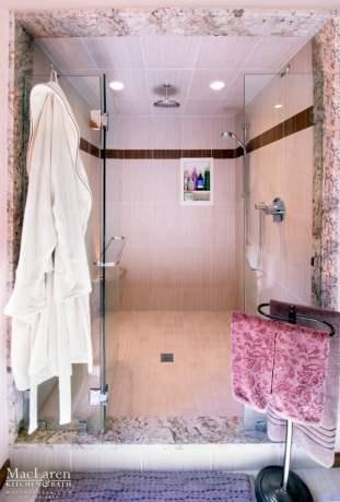 Furacan Bordeaux Granite shower frame, with custom made Corian Niche