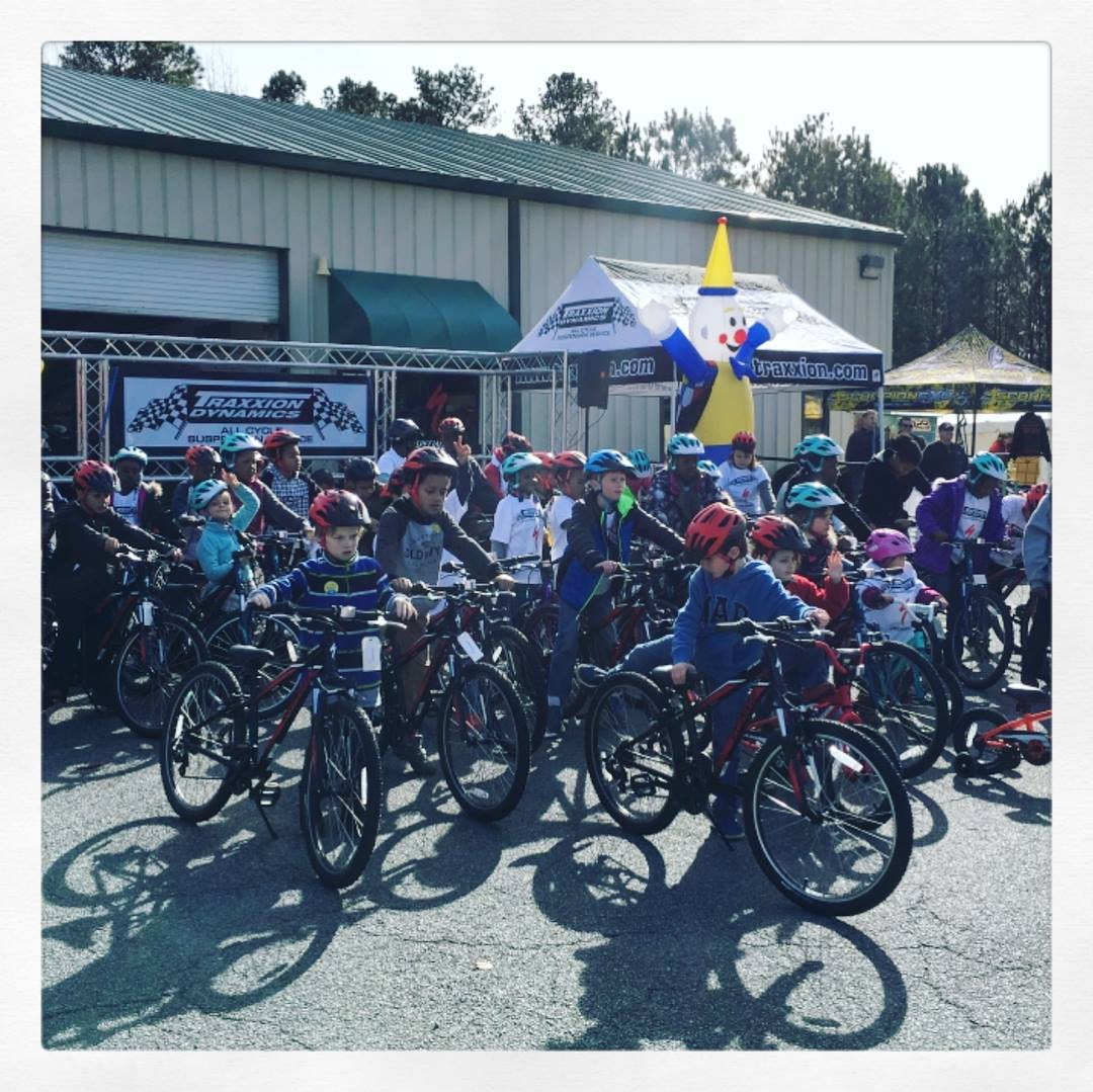 kids joining a bike ride as part of the Georgia Wellness and FItness Festival