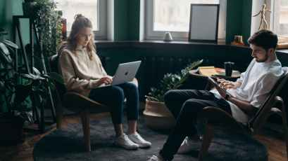 photo of two people using their gadgets