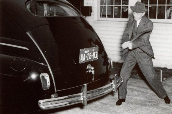 Henry Ford with axe trunk likd