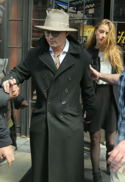 Amber Heard looks tired as she leaves the hotel with Johnny Depp in NYC