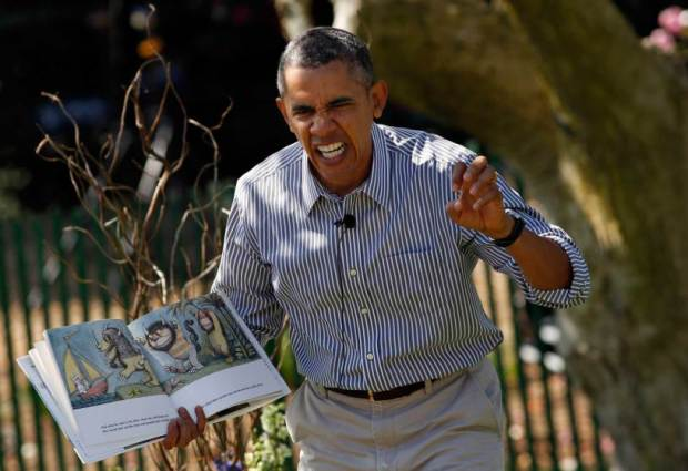 """Obama acts out the line """"gnashed their terrible teeth"""" from the children's book """"Where the Wild Things Are"""" during the 136th annual Easter Egg Roll on the South Lawn of the White House in Washington"""