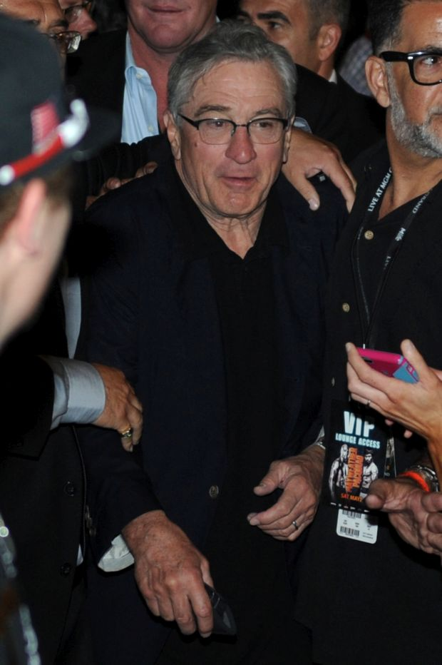 Robert De Niro gets mobbed as he leaves the Mayweather fight in Las Vegas!