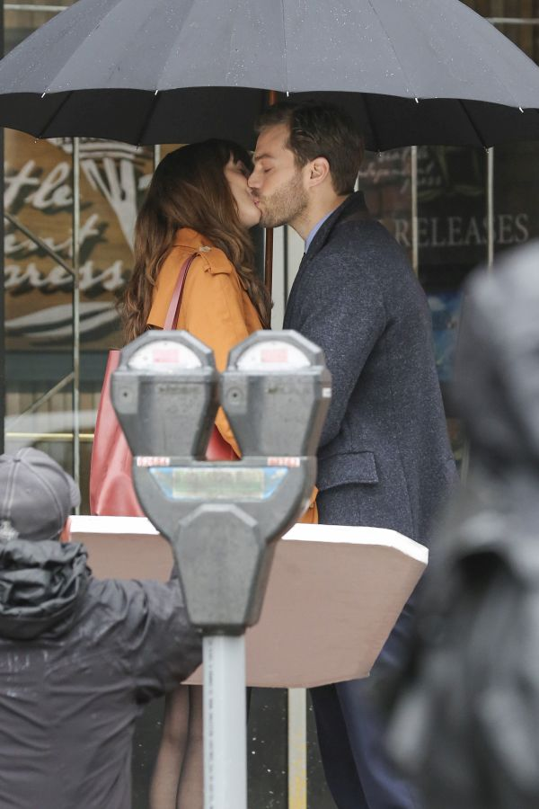 Jamie Dornan and Dakota Johnson are back in Vancouver to begin production on 'Fifty Shades Darker' the sequel to last year's $500M+ hit to 'Fifty Shades of Grey.' Now sporting some bad boy scruff, Jamie Dornan waits for Dakota Johnson outside of 'Seattle
