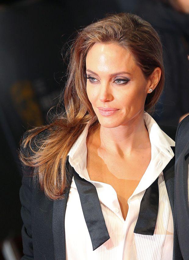 Brad Pitt and Angelina Jolie arrive at The 2014 EE BAFTA Awards, London