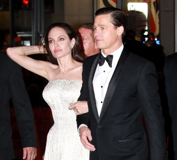 NO JUST JARED USAGEAngelina Jolie dazzles in white jewel encrusted gown husband Brad Pitt looks dapper in black tuxedo for LA By The Sea premierePictured: Brad Pitt, Angelina JolieRef: SPL1170958  061115  Picture by: Splash News<B