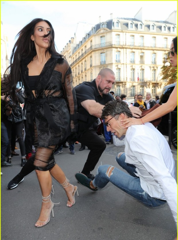 52188111 Ukrainian journalist Vitalii Sediuk is seen attepmting to kiss reality star Kim Kardashian's butt while at the Avenue restaurant in Paris, France on September 28, 2016. Vitalii quickly regretted this decision as he was immediately tackled to the ground by Kim's massive bodyguards! Vitalii also recently made headlines after grabbing Gigi Hadid outside the Max Mara fashion show in Milan. FameFlynet, Inc - Beverly Hills, CA, USA - +1 (310) 505-9876 RESTRICTIONS APPLY: USA ONLY