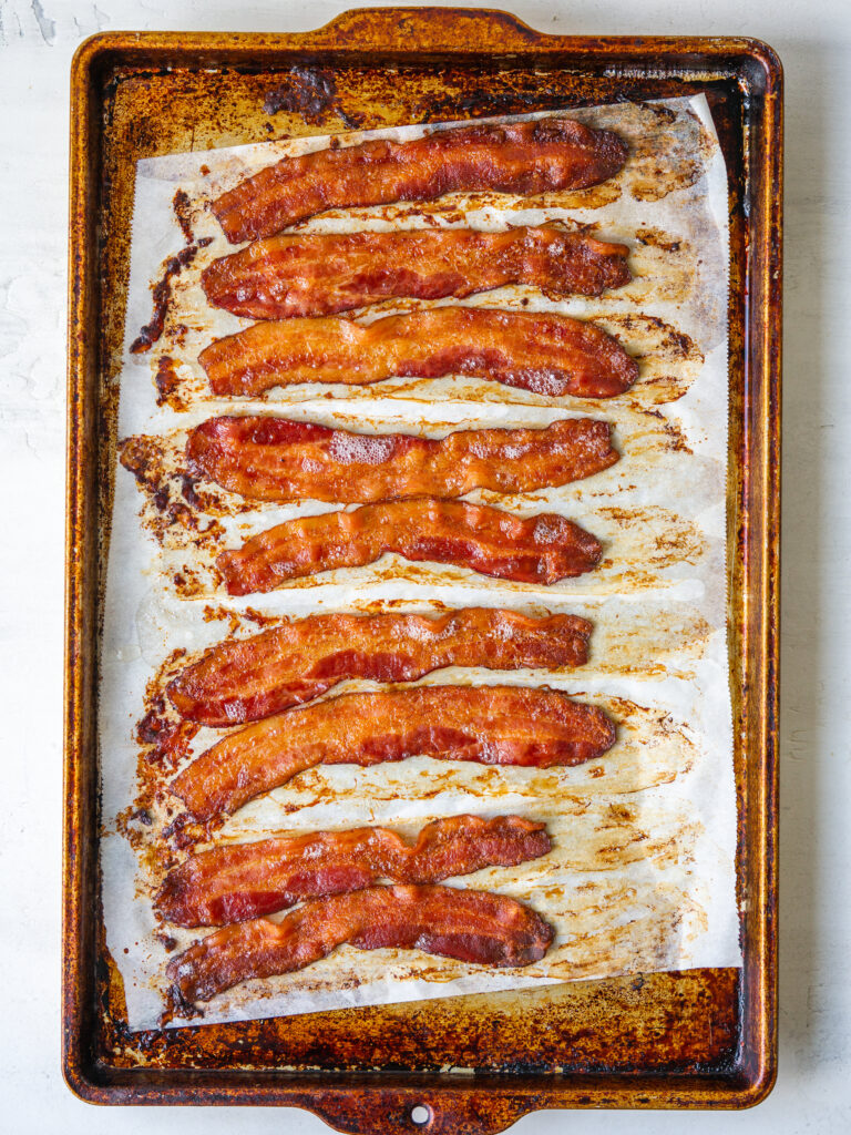 Above view of baked bacon recipe on a baking sheet