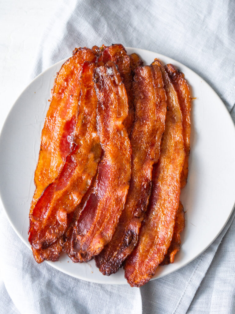 Above view of strips of crispy bacon on a plate