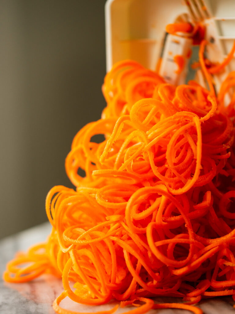 Side view of carrot noodles made with a spiralizer