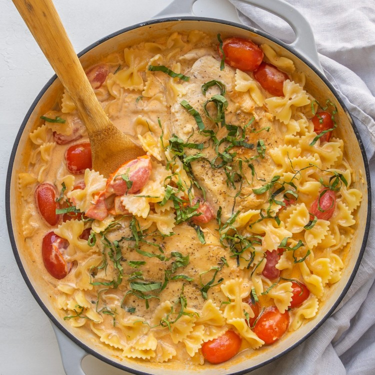 Above view of creamy tomato basil chicken in a frying pan