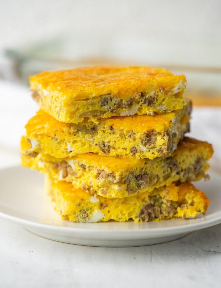 Side view of slices of cheese burger breakfast casserole made with ground beef and eggs