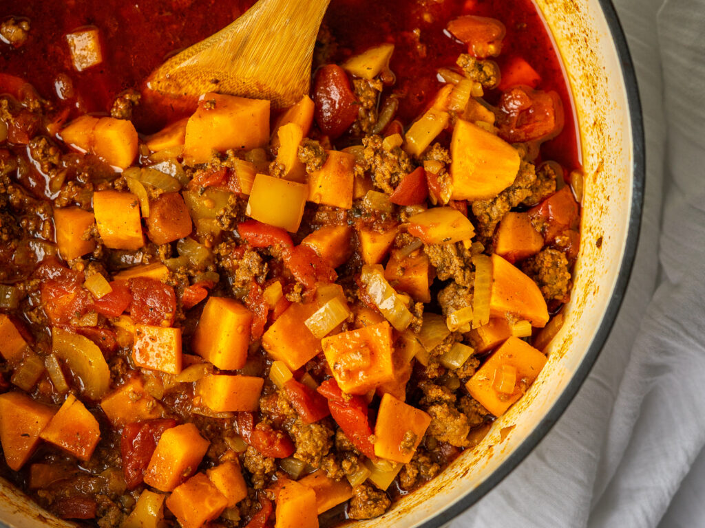 Above view of sweet potato paleo chili in a dutch oven