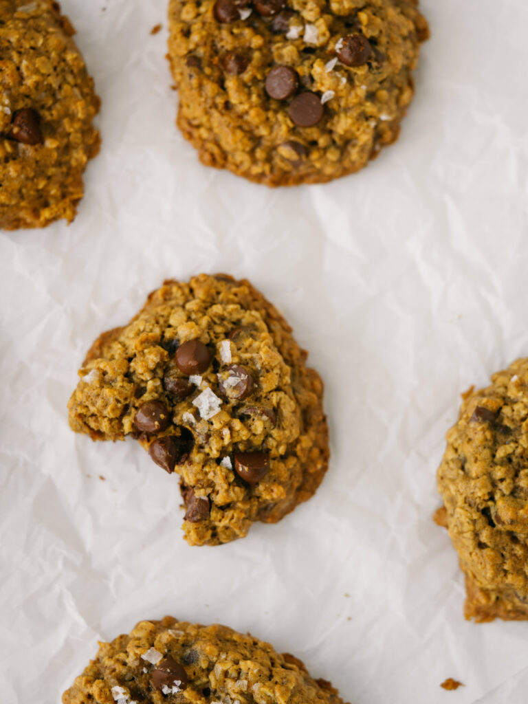 Above view of chocolate peanut butter oatmeal cookies of a parchment paper