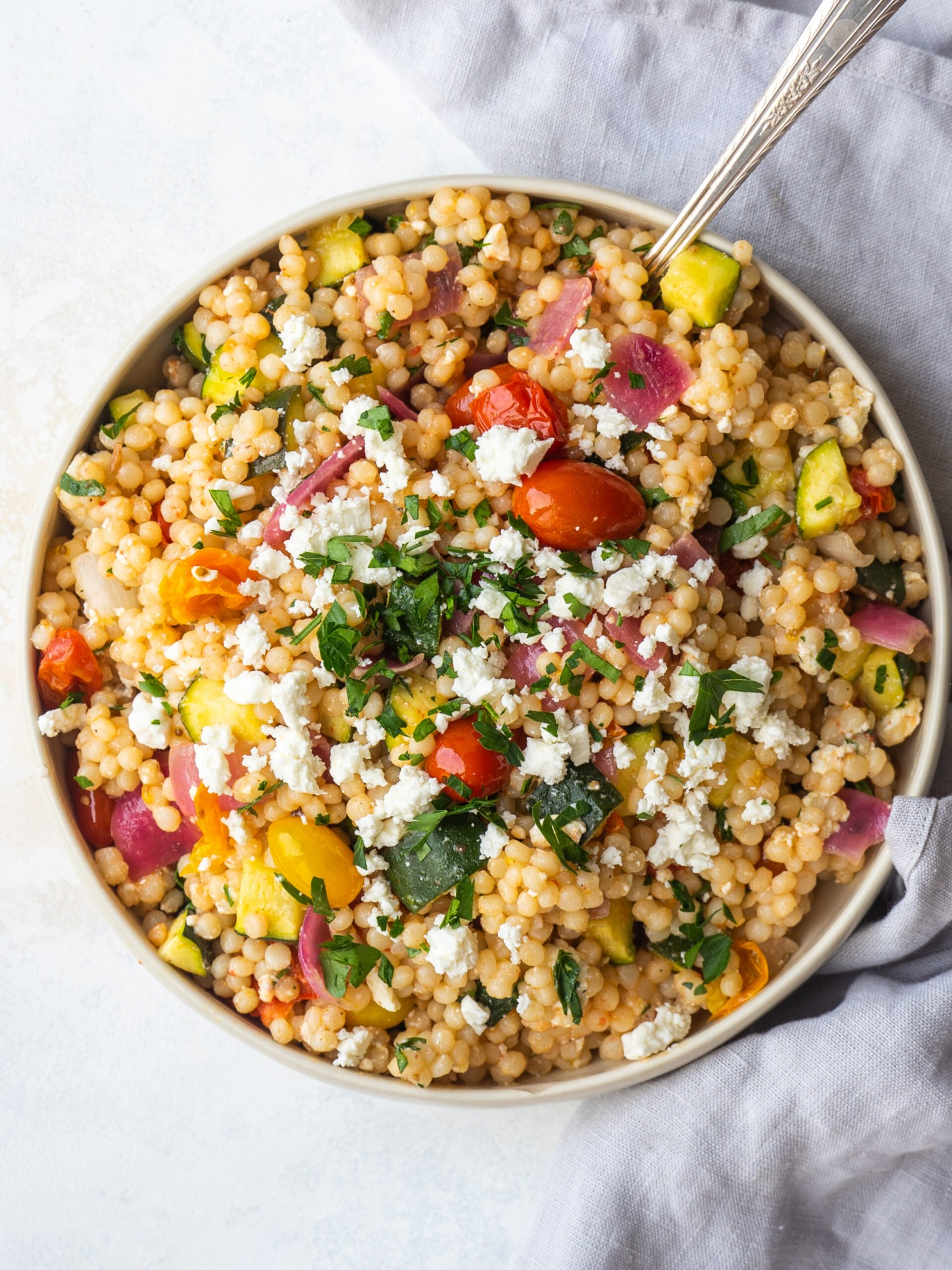 Above view of veggie couscous salad recipe in a serving bowl