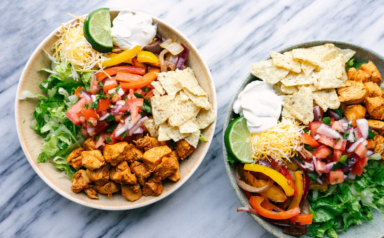 Above view of two chicken fajita salad recipes