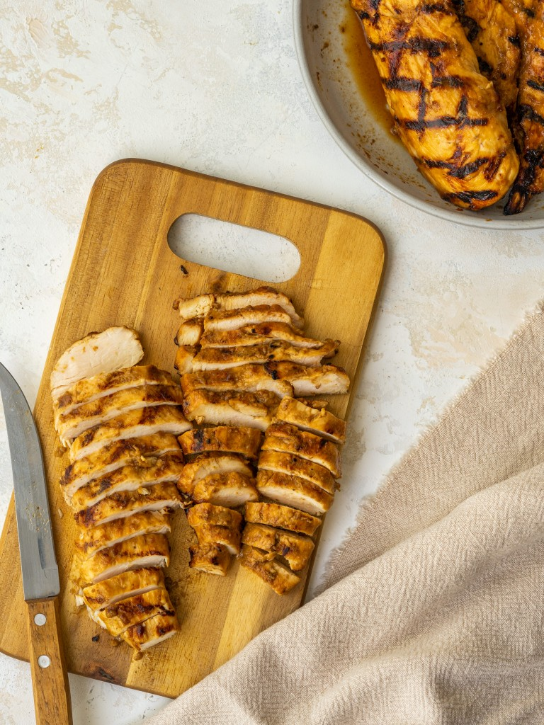 Above view of sliced balsamic grilled chicken on a cutting board