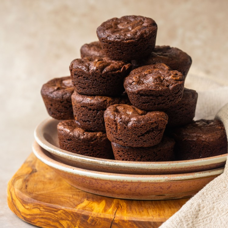 Side view of fudgy brownie bites on a serving plate