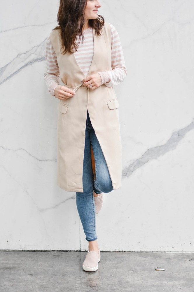 Styling a structured vest with a casual outfit of a striped sweater with jeans and sneakers. SPRING LAYERING OUTFIT: STYLED 3 WAYS