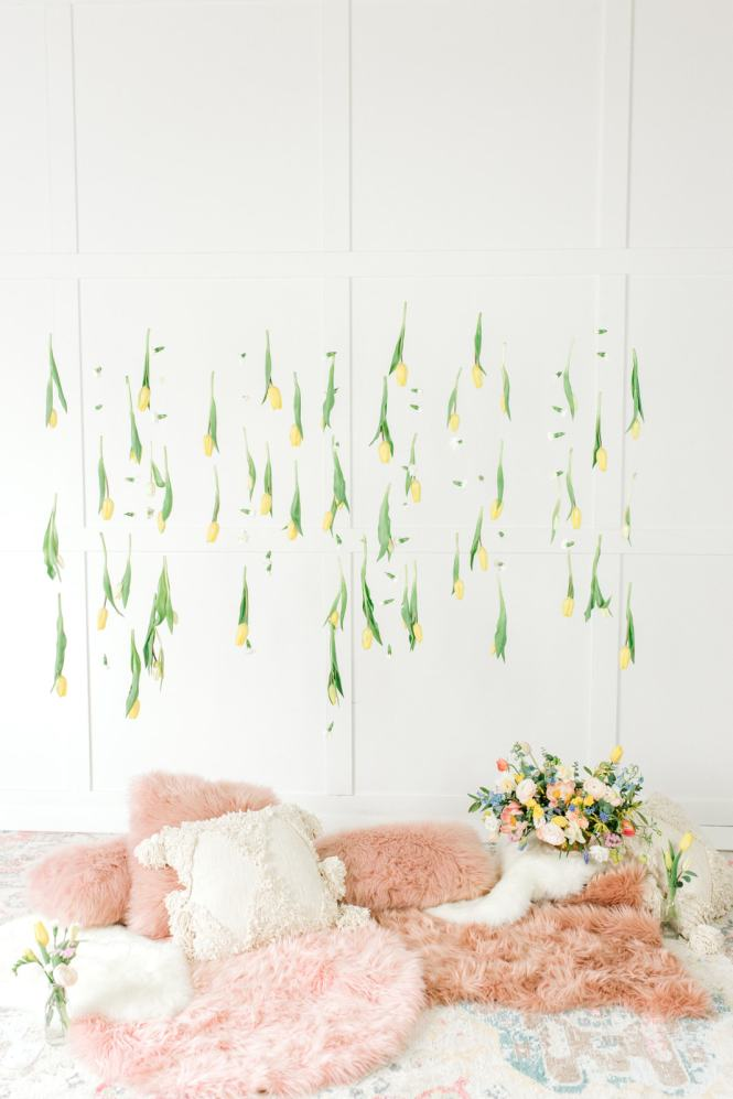 hanging florals, pastel rug and fluffy pillows