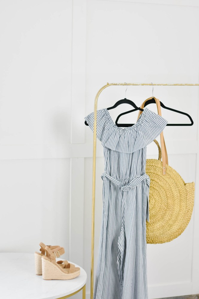 stripe jumpsuit, tan wedges and a oversized round straw tote.