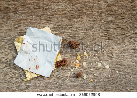 stock-photo-empty-chocolate-pack-on-wooden-board-359052908