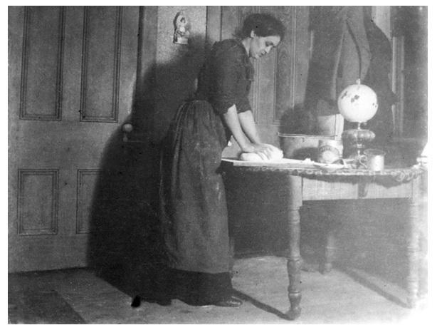 Mabel Mather making bread