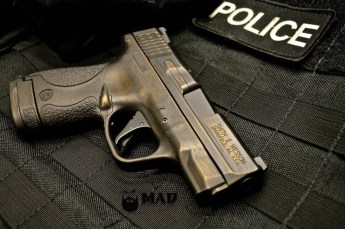 M&P Shield in War Torn Cerakote Burnt Bronze & Black
