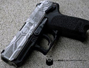 MAD Hidden Dragon on a H&K USP slide with Cerakote Armor Clear