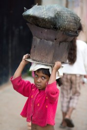 Child and charcoal stove