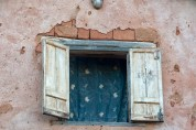Typical window, and muddy wall