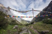 Prayer flags leading to the village