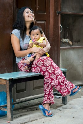 Mother and child in a narrow alleyway in Patan