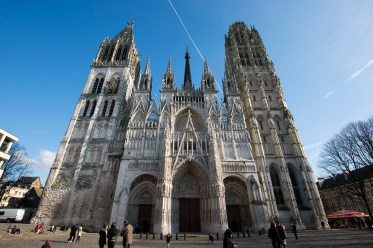 """The front facade, with the """"Saint-Romain"""" tower on the left and """"Butter Tower"""" on the right. One can see the central spire too."""