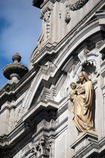 A statue on the front facade of the Église Saint-Antoine, which is no longer actually a church.